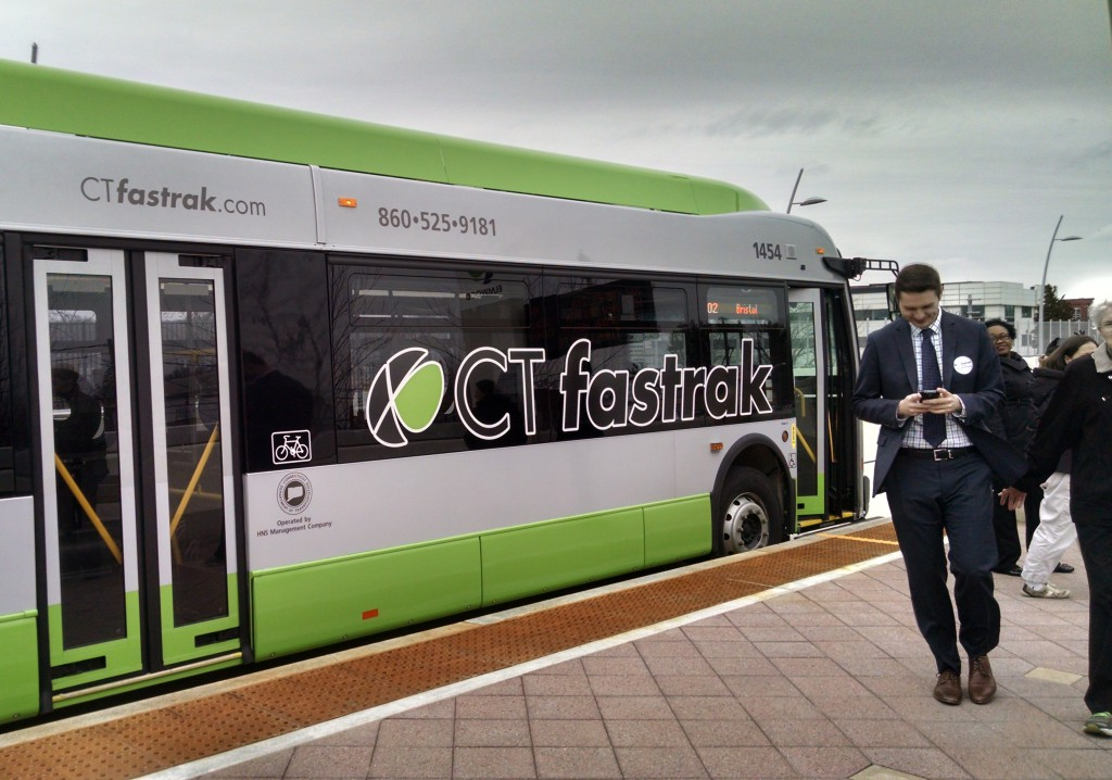 A CT fastrak bus at a station.