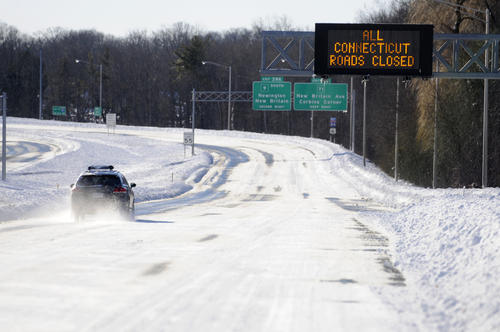 Snow covered Interstate highway: All Connecticut roads closed due to blizzard